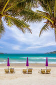 Beach chairs on sand beach — Stock Photo
