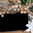 Tablet computer (tablet pc) and Dry flowers — Stock Photo