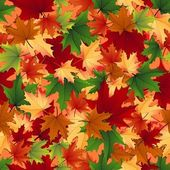 Seamless background of autumnal leaves — Stock Vector