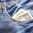 One dollar in jeans — Stock Photo