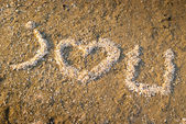Seashells heart on beach — Stock Photo