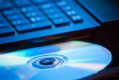 DVD in blue light — Stock Photo