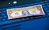 Banknote on keyboard — Stock Photo