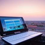 Laptop at sunset — Stock Photo #14048264