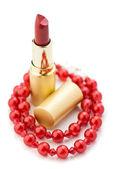 Lpstick and red jewelry — Stock Photo