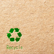 Photo: Cardboard with green recycle symbol