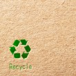 Foto Stock: Cardboard with green recycle symbol