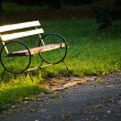 Wooden park bench - Stock Photo