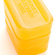 Three yellow soaps — Stock Photo