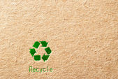 Cardboard with green recycle symbol — Stock Photo