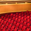 Red chairs in classic theater — Stock Photo