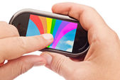 Rainbow on touch device — Stock Photo