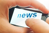 Word news on touch device — Stock Photo