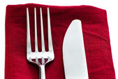 Fork and knife on napkin — Stock Photo