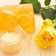 Yellow soap and rose — Stock Photo