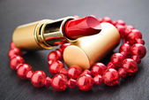 Red lipstick jewelry — Stock Photo