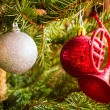 Christmas balls in tree — Stock Photo