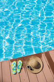 Flip-flop near swimming pool — Stock Photo