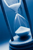 Hourglass in blue tint — Stock Photo
