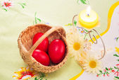 Candle and red eggs for Easter — Stock Photo