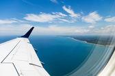 Coast through plane window — Stock Photo