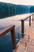 Stairs railing on lake dock — Stock Photo