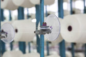 Cotton reels stacked in racks — Stock Photo
