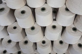 Cotton reels stacked together — Stock Photo