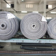 Rolled drapery in a jeans factory — Stock Photo