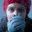 Cold Woman Behind Wet Glass — Stock Photo