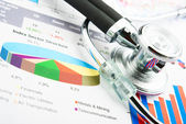 Stethoscope and statistics graphic — Stock Photo
