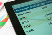 Currency exchange information on screen tablet pc — Stock Photo