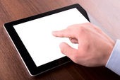 Hand on a touch screen of tablet pc — Stock Photo
