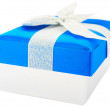 Blue gift box, bow and ribbons — Stock Photo