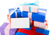 Gift boxes with greeting card — Stock Photo