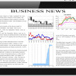 Tablet pc with business news on screen. - Stock Photo
