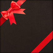 Brown gift with red bow — Stock Photo
