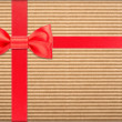Stock Photo: Wrapped vintage gift with red bow