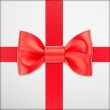 Wrapped vintage gift with red bow — Stockfoto