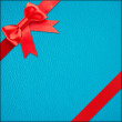 Stock Photo: Blue gift with Red bow
