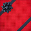 Stock Photo: Red gift with dark bow