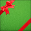 Stock Photo: Green gift with red bow