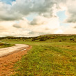 Asphalt road and cloudy sky — Stock Photo