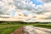 Asphalt road and cloudy sky — Stock Photo