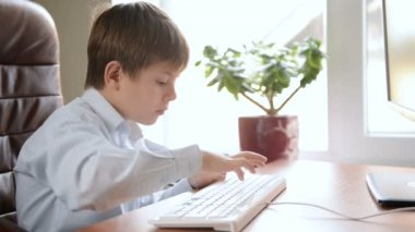 Child typing on keyboard. — Video Stock