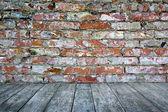 Interior stone wall wood floor — Stock Photo