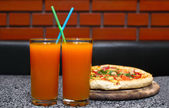 Juice and pizza — Stock Photo
