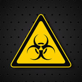 Biohazard symbol on dark background — Stock Vector