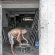 Stock Photo: Elderly metalworker in his garage