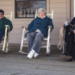 Three Seniors enjoying rocking on the Porch — Stock fotografie
